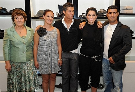 Family photo of the football player famous for Real Madrid & Sporting CP.