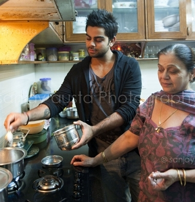Photo of Virat Kohli & his  Mother  Saroj Kohli
